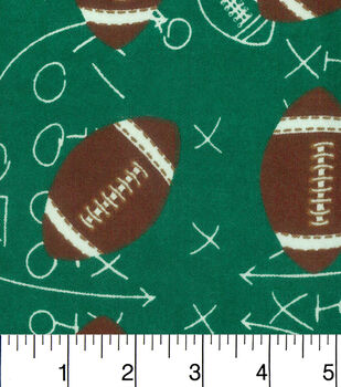 Snuggle Flannel Fabric-Footballs On Green