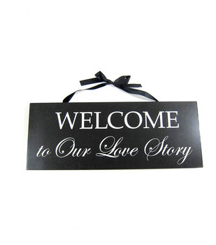 Welcome To Love Our Story Wall Hanging Black
