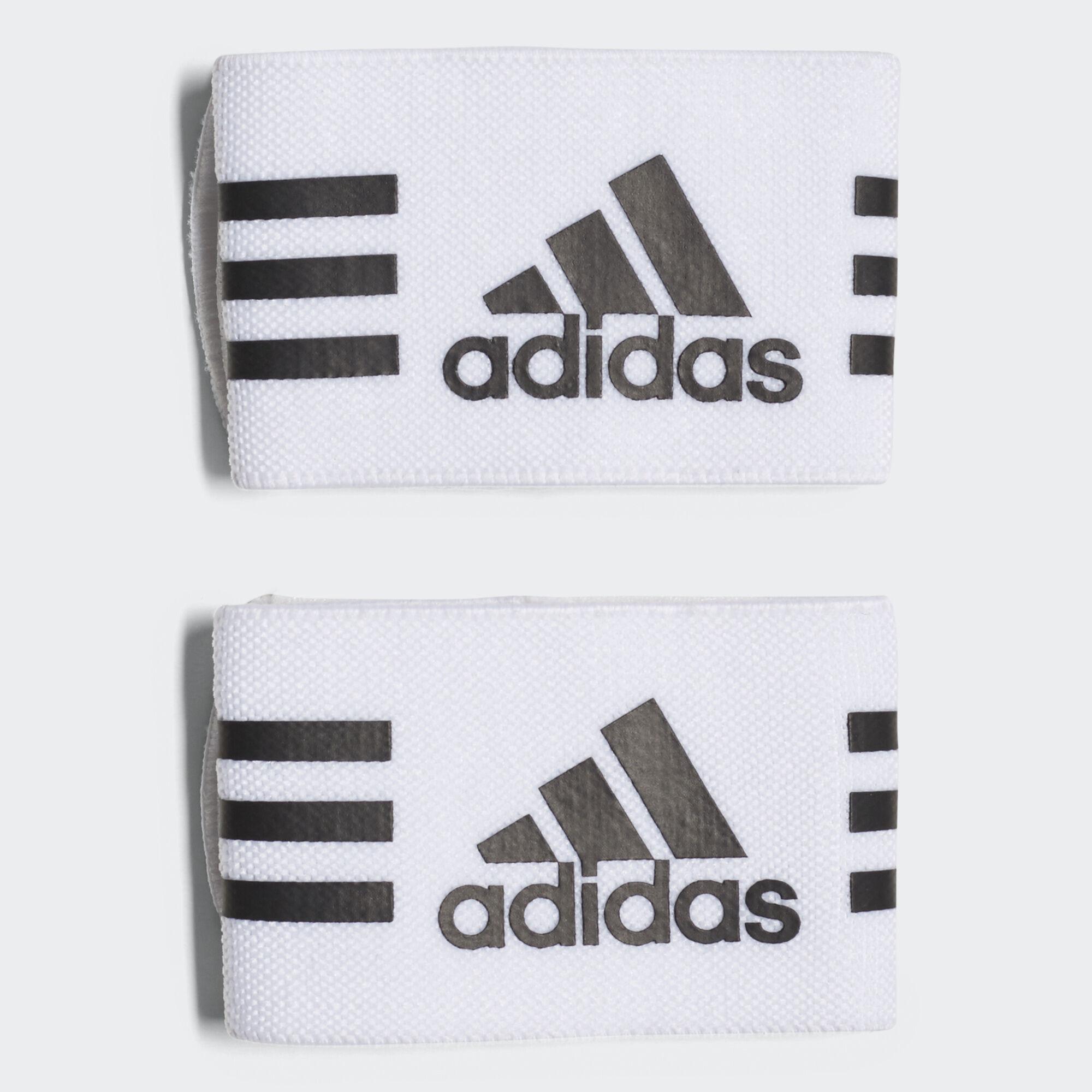 Fasce per parastinchi bianco adidas adidas italia for Adidas che cambiano colore