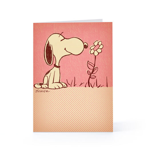 Snoopy Smelling a Flower