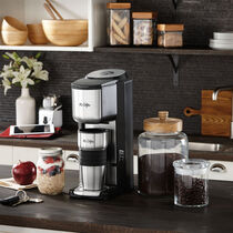 Mr. Coffee® Single Cup Coffeemaker with Built-in Grinder, with Travel Mug Included