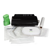 The FoodSaver® V2433 Vacuum Sealing System with Green FreshSaver® Handheld Sealer