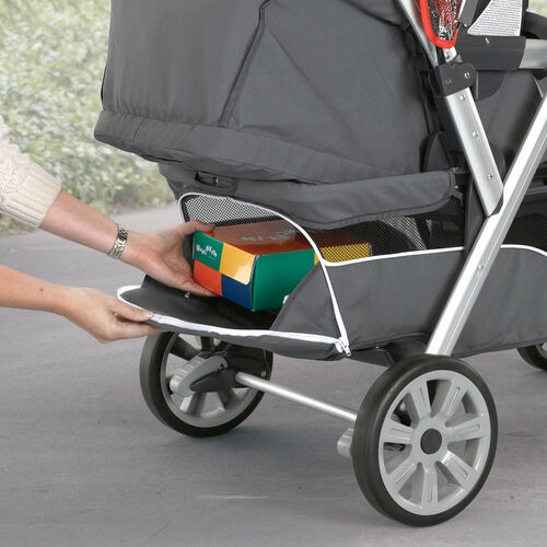 Cortina Together Double Stroller storage basket has a zippered flap that allows you to access the storage area even with the seat fully reclined
