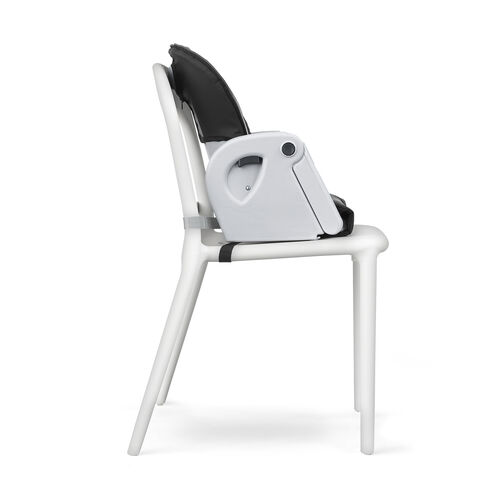 The highchair seat of the Polly Progress Relax multi-chair is easy to detach from its frame to create a high-back booster that secures to a dining chair
