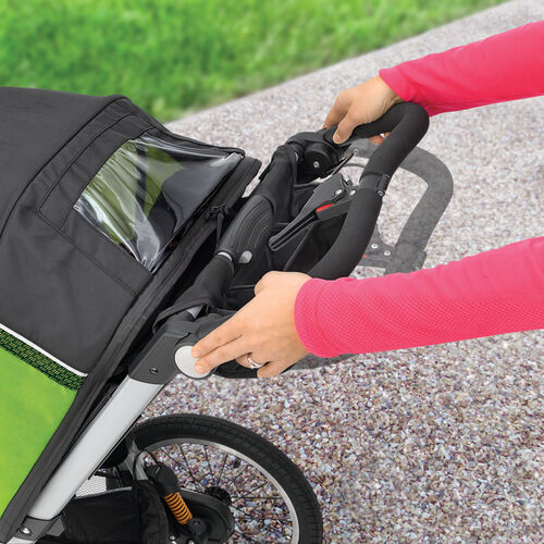 Height-adjustable handle quickly locks into place to account for height differences in parents