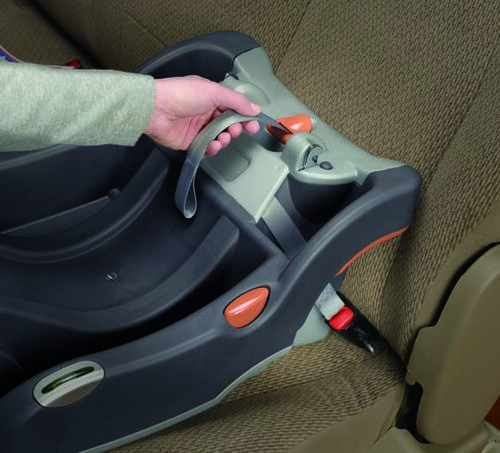 Tighten the LATCH straps on your KeyFit 30 infant car seat base by pulling the SuperCinch strap