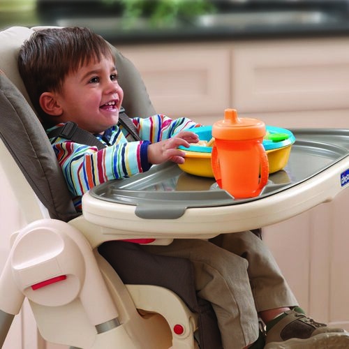 Young boy eating a meal with the Chicco Polly Highchair