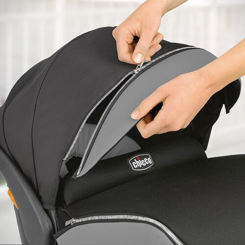 Unzip the front canopy of the KeyFit 30 Zip infant car seat to remove the extended canopy panel