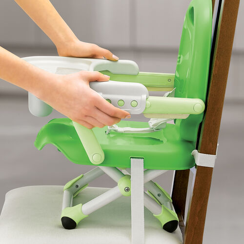 A detachable tray on the Pocket Snack Booster Seat can be used in three different positions