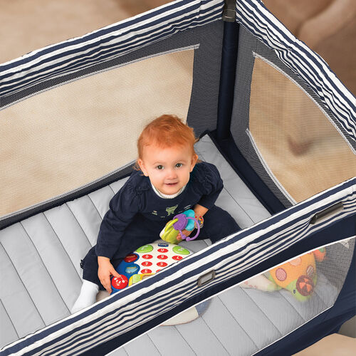 Baby will love playing in the spacious Lullaby Baby Playard by Chicco