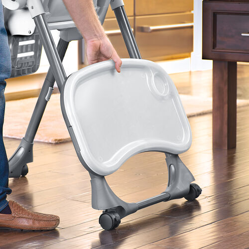 Store the highchair tray easily by snapping it onto the leg of the Polly highchair by chicco