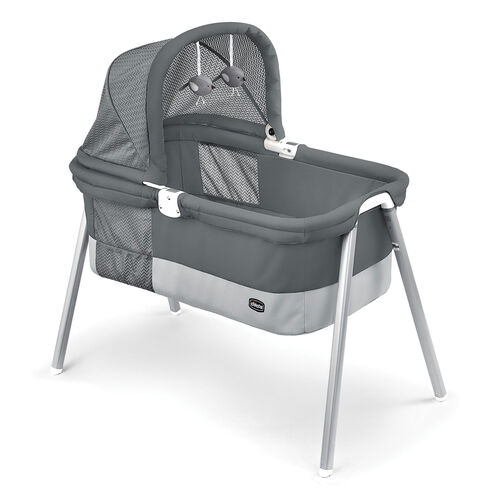 The Chicco lullago Deluxe Bassinet includes an adjustable canopy and toy mobile