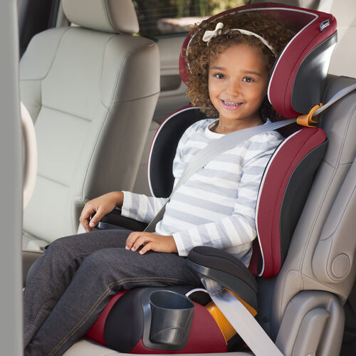 Girl seated in KidFit 2-in-1 Belt Positioning Booster Car Seat in high-back mode