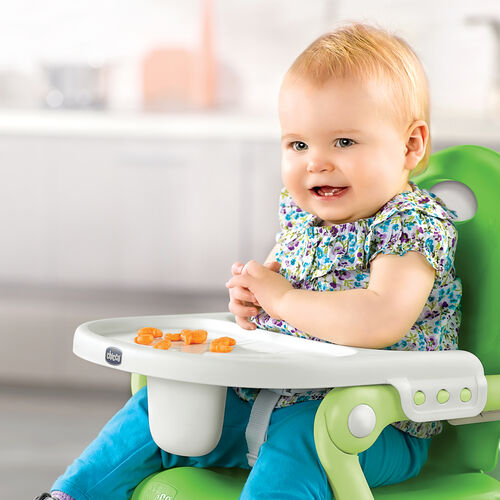 The Pocket Snack Booster Chair has a tray for baby to use when you don't want to use a table