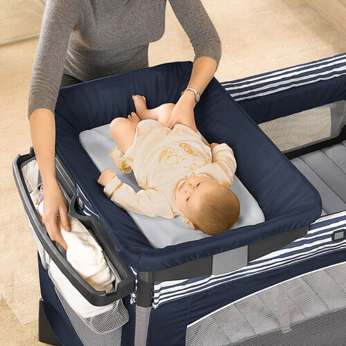 The Lullaby Baby Playard has a changing table that is easy to set up for a quick diaper change