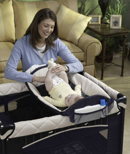 A spacious changing table allows for quick diaper changes with the Lullaby Playard