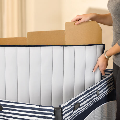 Zip and wash mattress pad has removable floor boards and is machine washable