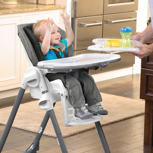 The convenient tray insert of the Polly Highchair wipes clean and stores on the back of the highchair after use