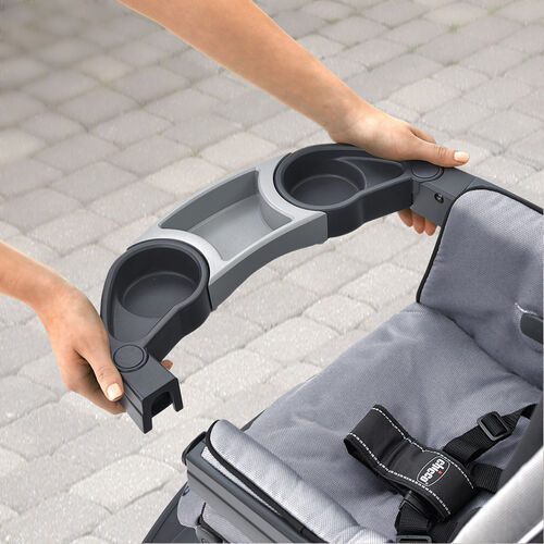 The child's tray on the Nuevo Stroller can be opened on one or both sides