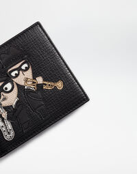 LEATHER WALLET WITH DESIGNER PATCH