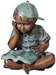 "Garden sculpture ""Crossed leg boy reading"", bronze"