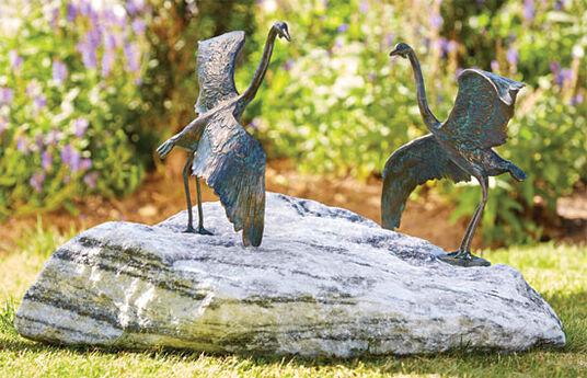 """Garden Sculptures """"Heron pair"""" on Zebra rock"""