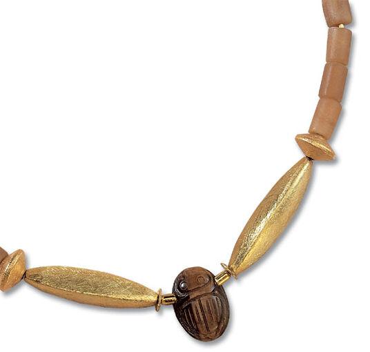 Petra Waszak: Scarab necklace of iridescent tiger eye