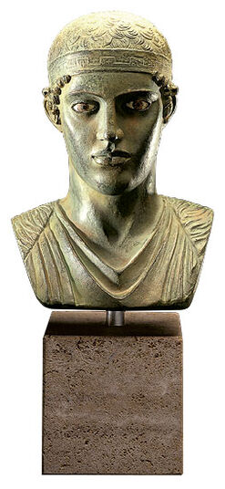 Bust of the charioteer of Delphi, bronze on marble diabase plinth