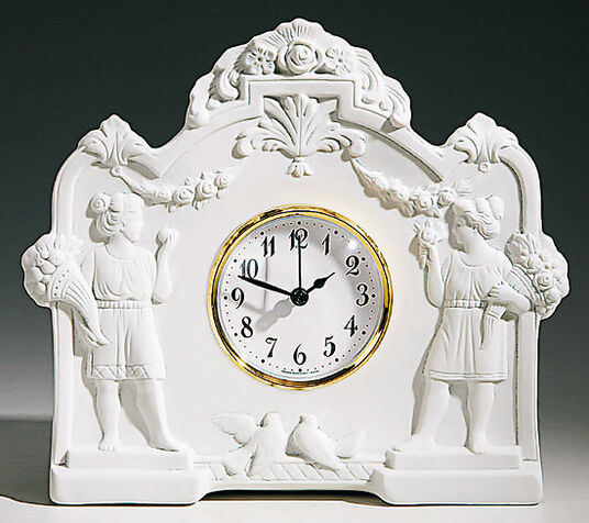 Art nouveau table clock of porcelain