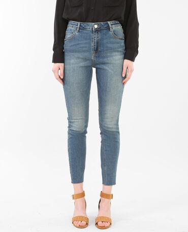 Jeans skinny tobilleros de talle alto raw cut azul lavado