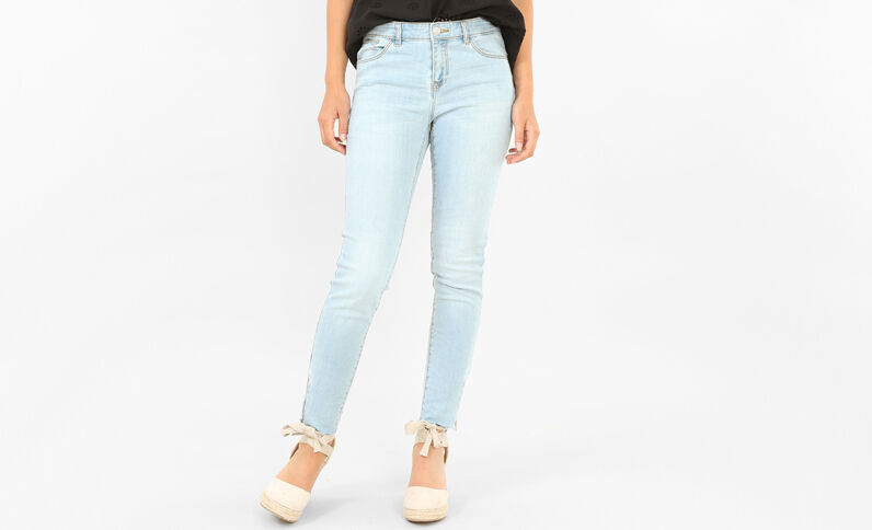 Jeans skinny raw cut cremallera azul claro