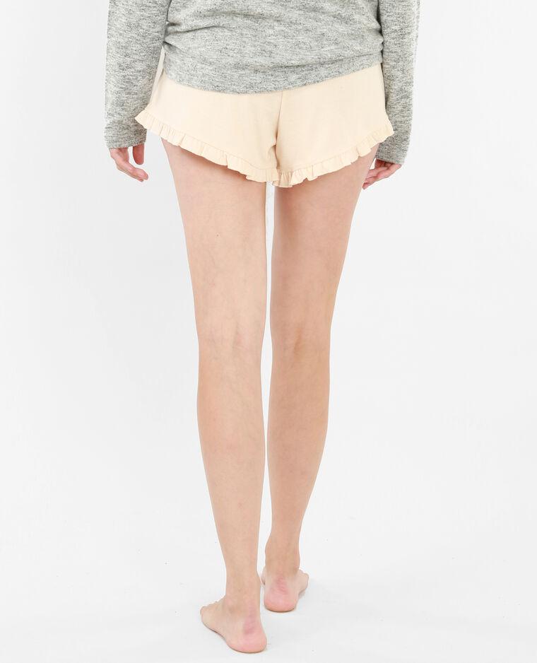 Short homewear con volante rosa maquillaje