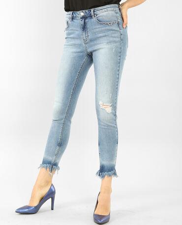 Jeans skinny con flecos y ojetes azul