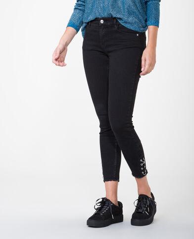 Jeans skinny con occhielli nero