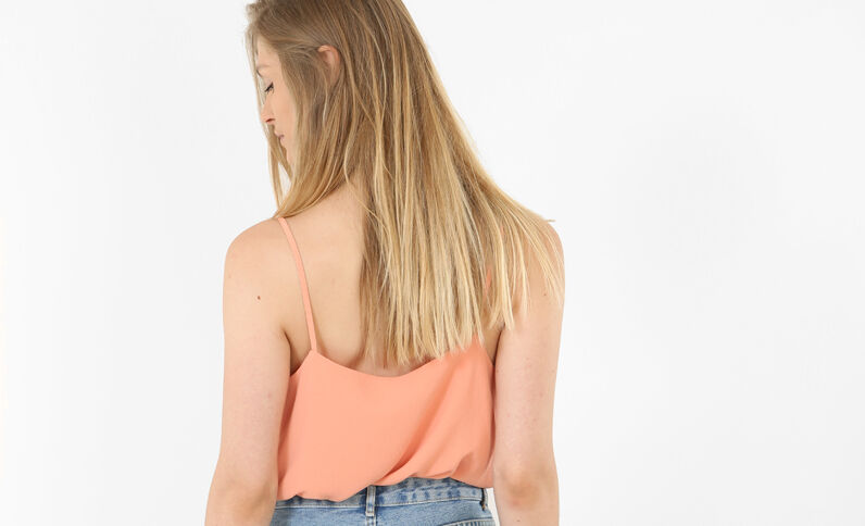 Top met bloemblaadjes oranje