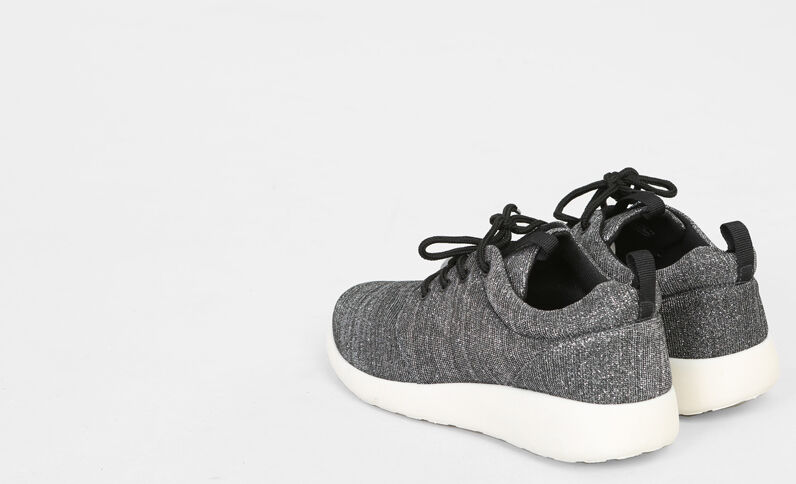 Zapatillas de running irisadas negro