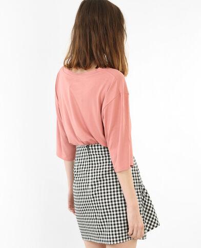 Camiseta ancha con mensaje rosa