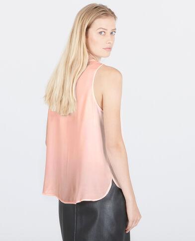 Blusa con bisutería rosa