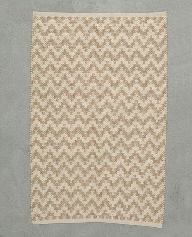 Tappeto tessuto zigzag bianco