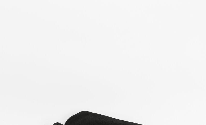 Grand plaid à pompons noir