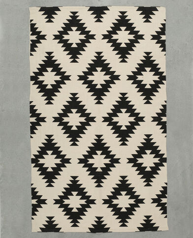 Katoenen tapijt met print zwart