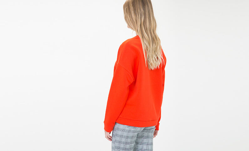 Sweater met opschrift rood
