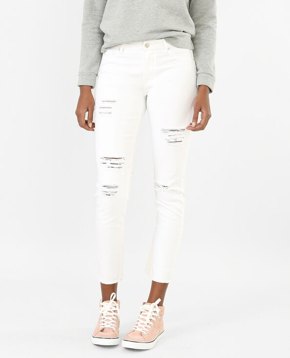 Skinny destroyed jeans wit