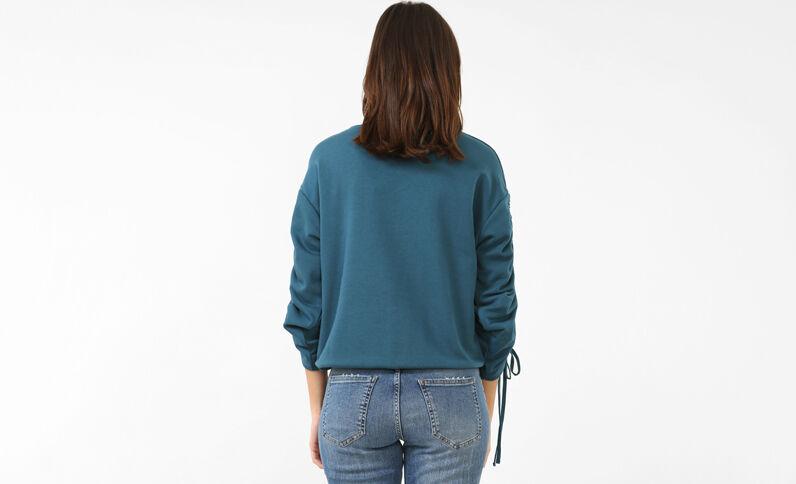 Jersey con bordados azulón