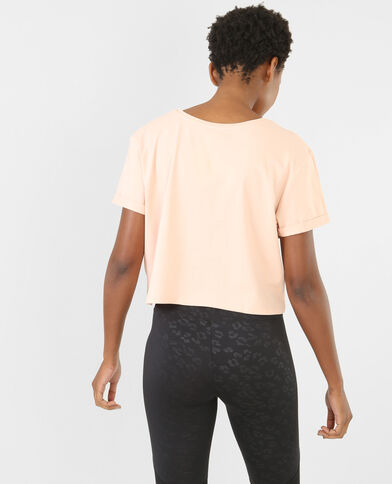 T-shirt cropped con scritta rosa