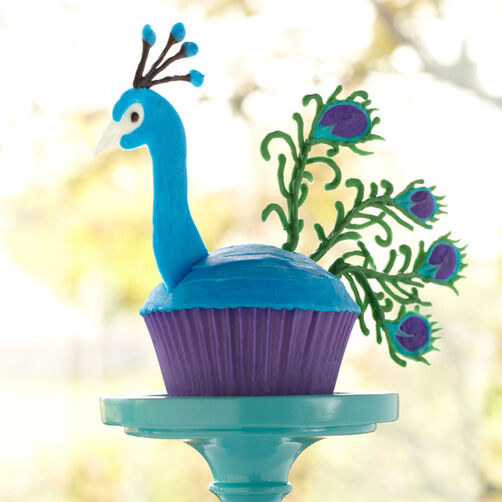 peacock cupcake with candy melt head and tail