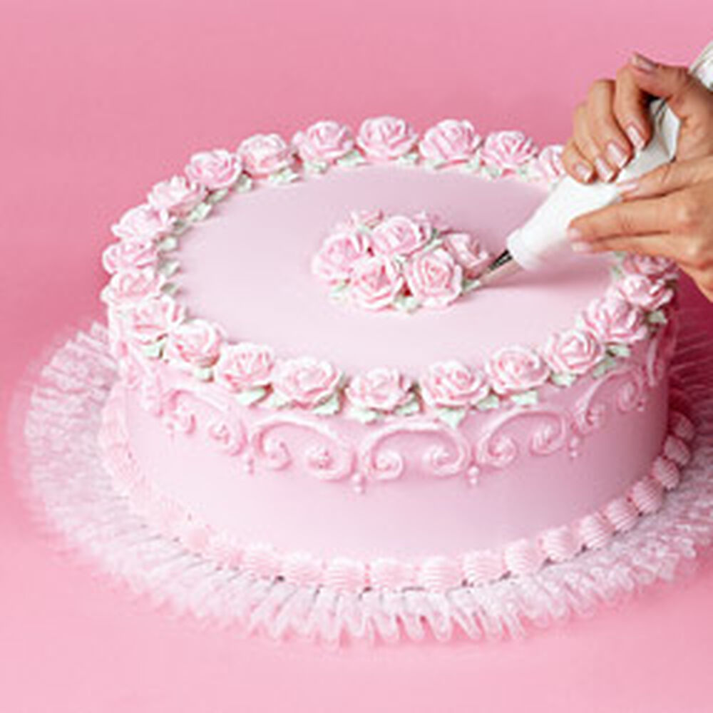 Cake Decorating Images : How to Add Tuk  N Ruffle To Cake Boards Wilton