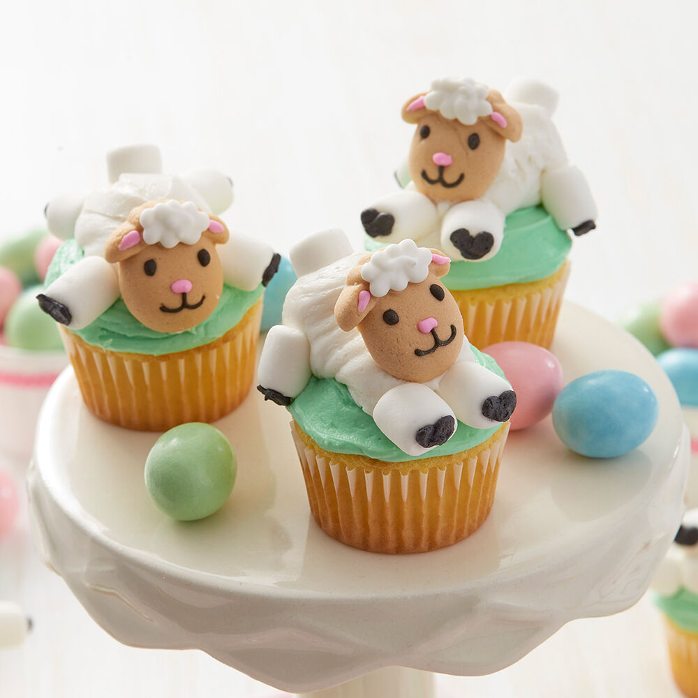 Little lamb mini cupcakes wilton for Cute cupcake decorating ideas for easter