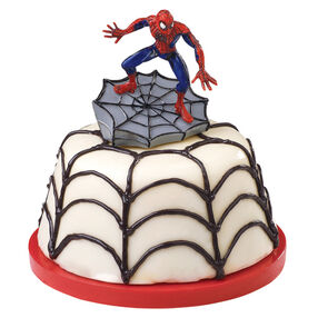 Candy covered cupcake with black spider web icing and a Spider Man decoration