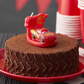 Cars 3 Brownie Tire Cake featuring a Lightning McQueen candle